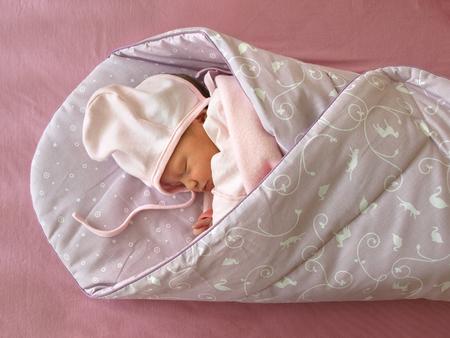 0 1 months: Newborn sleeping in the Swaddle Wrap Blanket