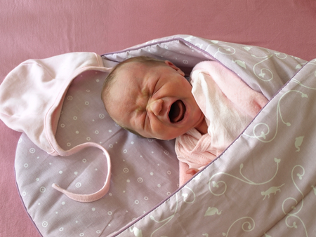 swaddled: Newborn screaming in the Swaddle Wrap Blanket Stock Photo