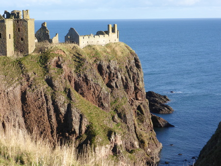 Dramatic, romantic and haunting ruined cliff top fortress near Stonehaven, Aberdeenshire, Scotland.