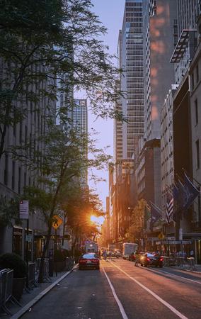 NEW YORK, sunset between the Manhattanhenge solstice skyscrapers