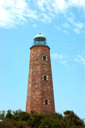 henry: Brick lighthouse at Fort Henry with clouds