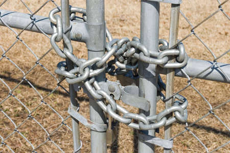 Chain and lock on a chain link fence photo