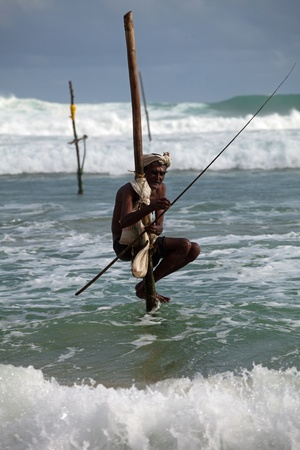 galle: Stilt Fishing is unique to South Asia Stock Photo
