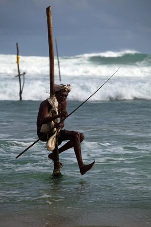 Stilt Fishing is unique to South Asia Standard-Bild