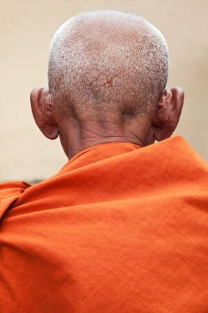 monasticism: Back of the old Buddhist monk Stock Photo