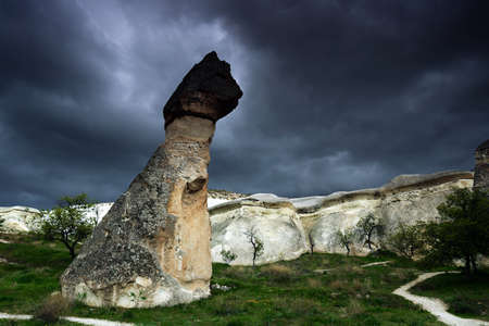 Rock formations near Goreme, Cappadocia, Turkey, on the background of dark stormy sky