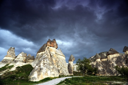 limestone: Rock formations near Goreme, Cappadocia, Turkey, on the background of dark stormy sky