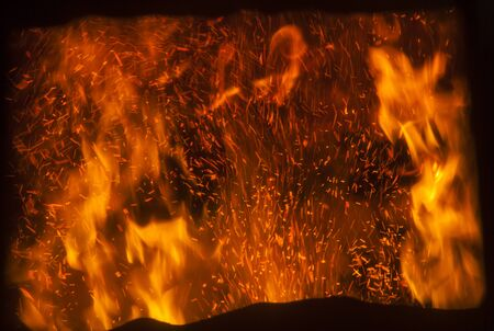 the flame inside a special furnace for burning sawdust Standard-Bild