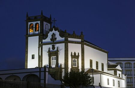 Tower of St. Sebastian church (Igreja Matriz de Sao Sebastiao) in evening, sunset