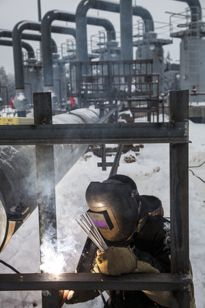 Welding work on the construction of an industrial enterprise inwinter