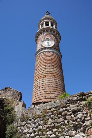 civic: brick clock tower in Italy