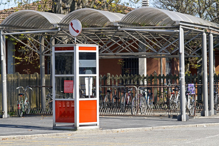 a phone booth. despite globalization and the spread of mobile phones in some places there are still phone booths