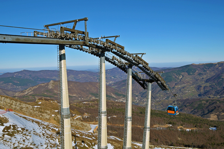 Chairlift mechanical pulleys in ski resort . Gear cable car Stock Photo