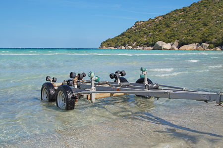 Boat Trailers in the beach on the tropical sea