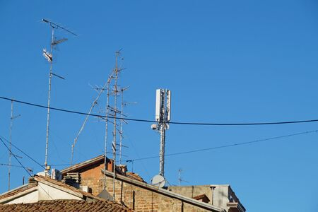 television antenna on roof with blue sky. Stock Photo