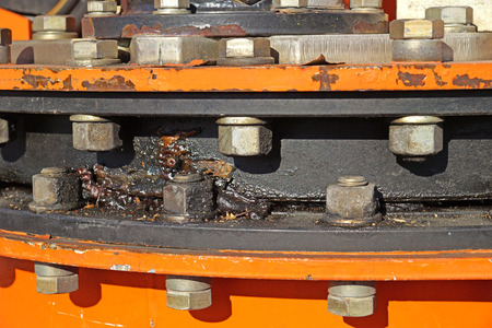 bolts and nuts: crankcase with bolts . machine equipment heavy part at work