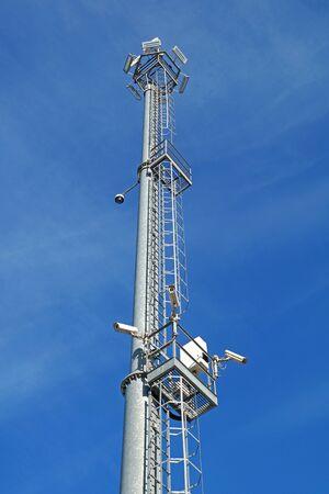 lighting fixtures: Surveillance cameras and modern lighting fixtures on the lamppost .