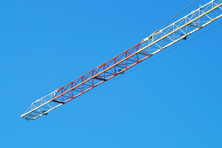 Crane boom in operation.  of mobile  with blue sky background.