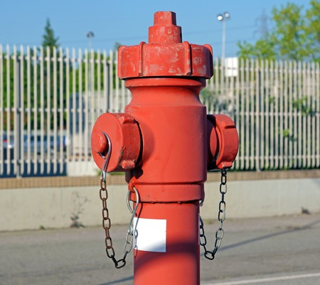Red fire hydrant water pipe near the road.   for emergency  access