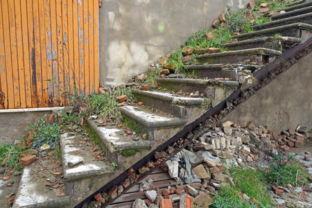 Old staircase in an abandoned house that has been after the earthquake Stock Photo