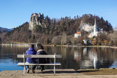Senior man and woman relaxing at lake