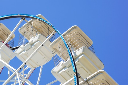 Underside view of a ferris wheel rotating downward. Stock Photo