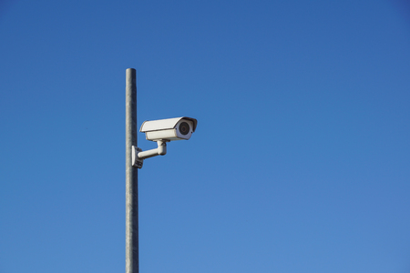 Laterally camera on a post in bue sky