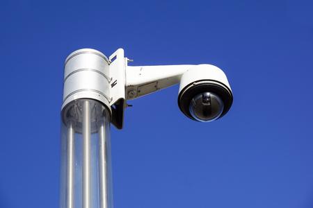 High tech overhead security camera with a blue sky Stock Photo