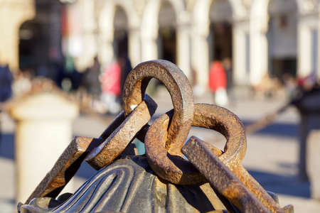Metal chain with big ring. Close up texture of rocky surface with iron chain and ring on it Stock Photo