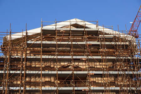 Extensive scaffolding providing platforms for work in progress on a church in restructuring . Stock Photo