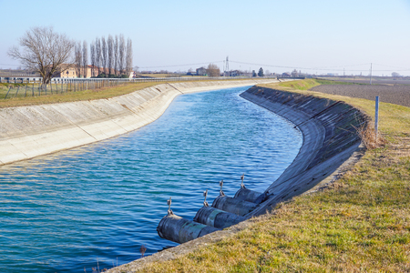 Irrigation canal between agricultural crops