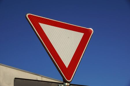 precedence: roadsign, give priority with blue sky in background Stock Photo