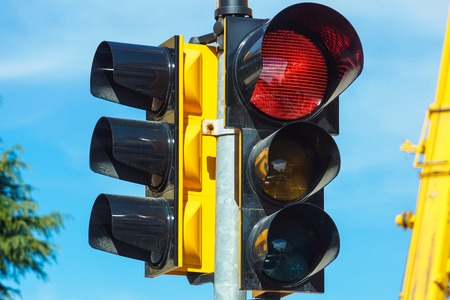 stop and go light: Red traffic light in the city street
