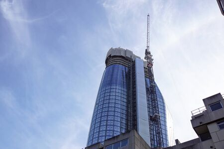 forsale: LONDON, ENGLAND - APRIL 25: One Blackfriars modern glass steel apartment block under construction. In London, England. Editorial