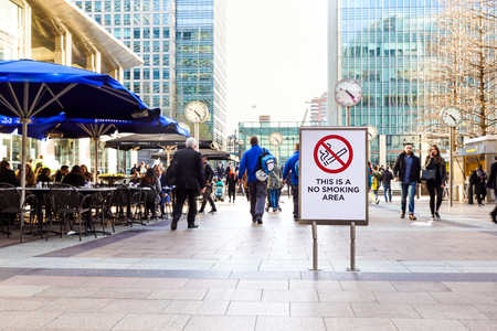 banned: LONDON, ENGLAND - APRIL 25: Signal no smoking area. There are several non-smoking areas in the canary wharf district of london. There is growing sensitization to quit smoking .