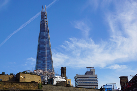 tallest bridge: LONDON - APR 20 : The Shard building and riverside pictured on April 20th, 2013, in London. The Shard opened to the public on February 2013. Standing 309m, the Shard is the tallest building in Europe. Editorial