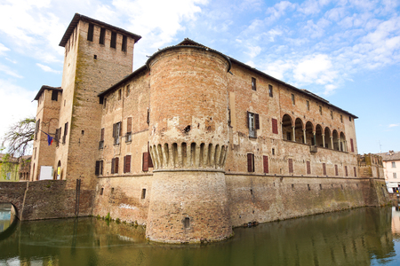 PARMA, ITALY - APRIL 2017 : The Rocca Sanvitale of Fontanellato stands, charming, in the center of the village, surrounded by a wide water-filled moat: it contains one of the masterpieces of Italian mannerism