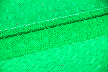 green metal diamond floor plate light and shadow texture background