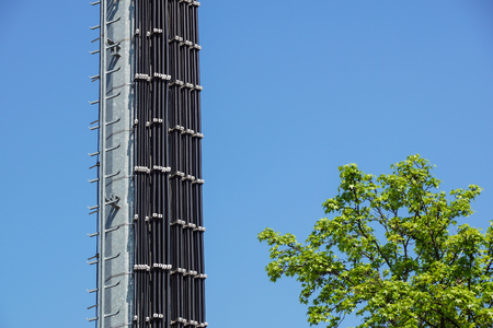 telephone poles: Industrial tower and stairs against the blue sky. Stock Photo