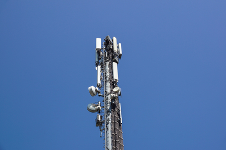 Communication antenna tower with blue sky background