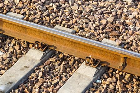 rusts: iron rusty train railway detail over dark stones rail way