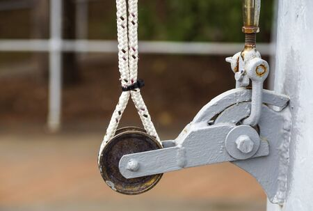 the pulley for pulling the flag on the pole .