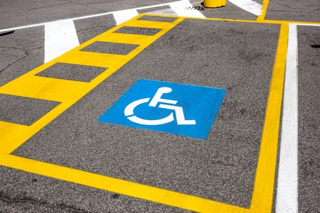 parking space reserved for handicapped shoppers in a retail parking lot. Stock Photo