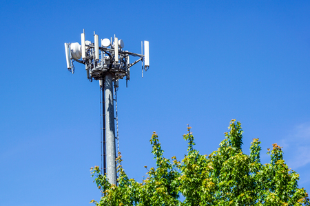 Telecommunications towers are located on the cloud forest detail and beautiful sky background. Stock Photo
