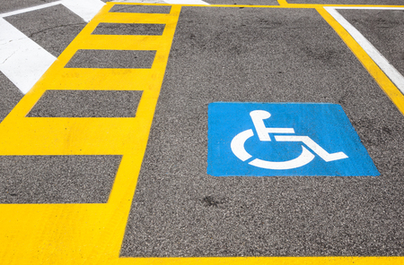 parking space reserved for handicapped shoppers in a retail parking lot. Banco de Imagens