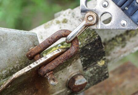old climbing carabiner .metal hook rusty