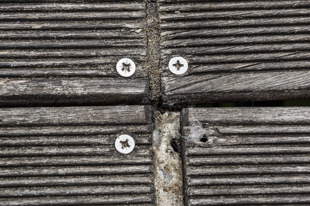 Close up of wooden jetty screws . wooden board for walk Stock Photo