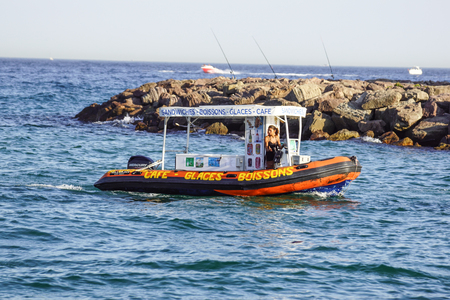 sell: Nice , France - 5 august 2017 : outdoor river coffeshop and bar on boat , to sell drinks on the beaches directly from the boat Editorial