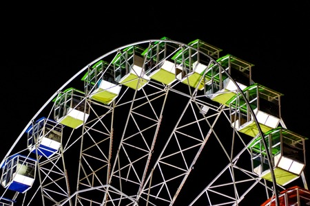 detail of a night-time panorama wheel lit by lights .