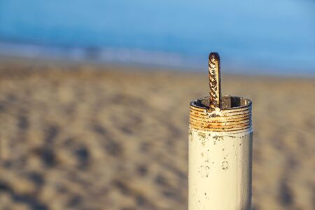 Pipe threaded both isolated on beach at background Stock Photo